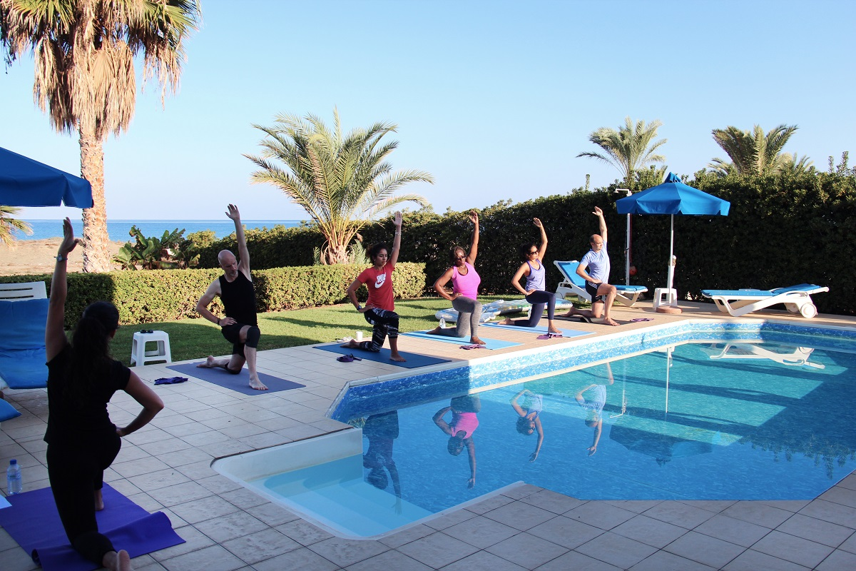 Hip-stretch-at-a-Pilates-class-by-the-pool-during-the-Cyprus-retreat