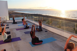 Shoulder-stretch-at-a-yoga-class-during-the-Cyprus-retreat