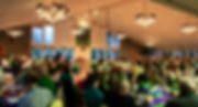 The Ballroom full of people enjoying a St. Patrick's Day party