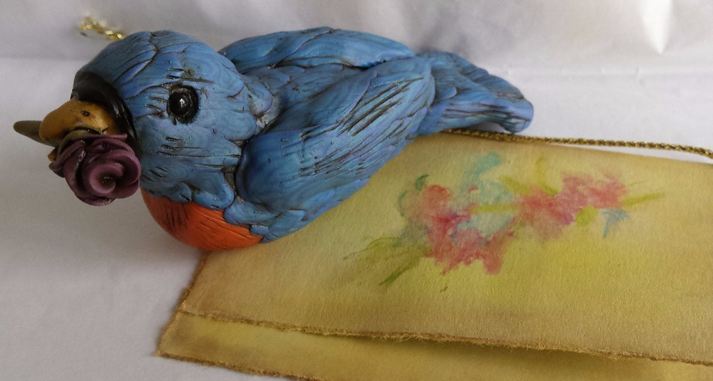 bluebird with a rose