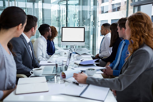 Business people looking at a screen during a video conference in the conference room.jpg