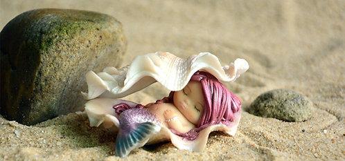 Petite sirène dans son coquillage