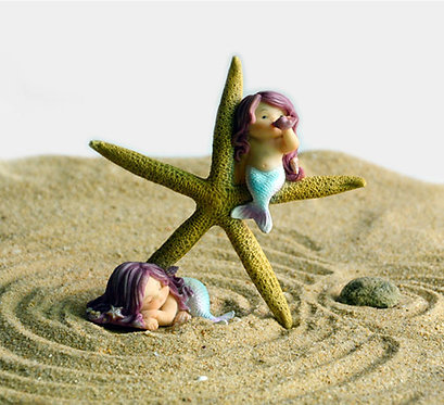 Petites sirènes et leur étoile de mer