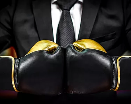 Businessman with boxing gloves is ready