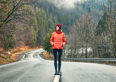 Girl Walking in Empty Road.