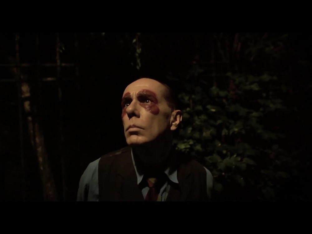 A still from the film Gelateria, directed by British-Italian Christian Serritiello. A man in clown makeup looks mournfully off-camera.