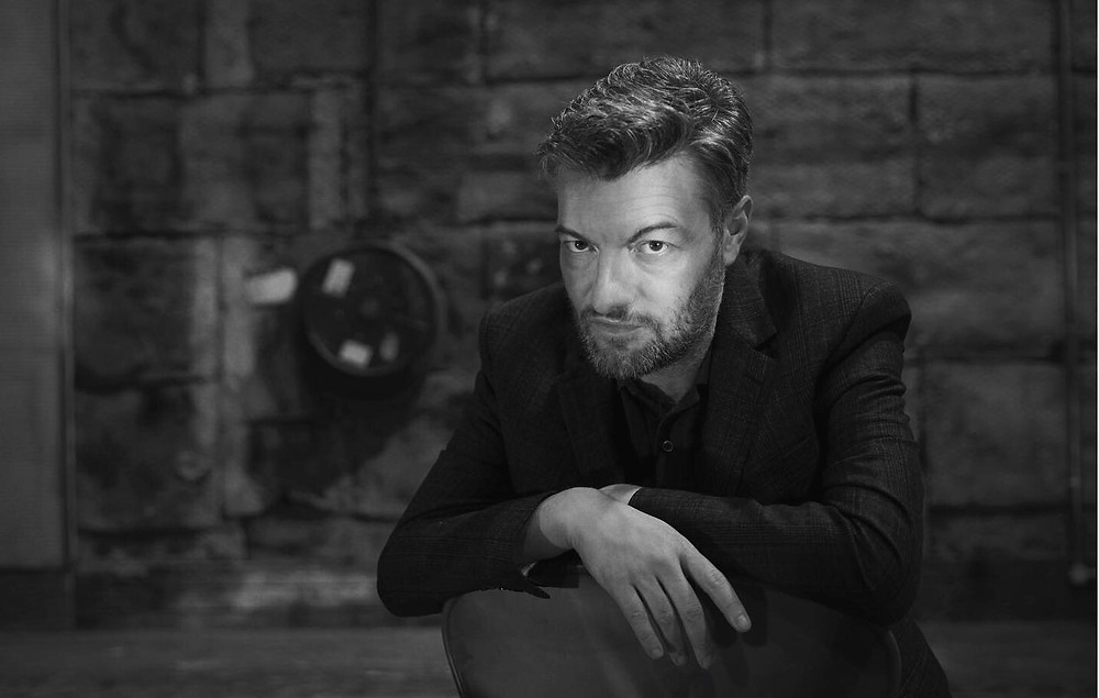 Charlie Brooker, writer of Black Mirror. black and white monochrome dark