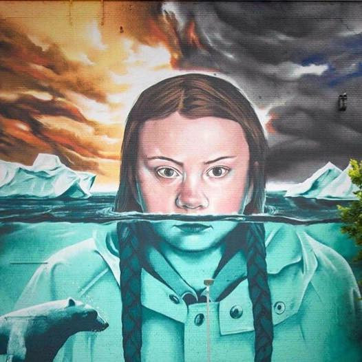 A photograph of a painting of Swedish climate activist Greta Thunberg. Greta is half submerged in a melting Arctic ocean with a polar bear, staring at the viewer.