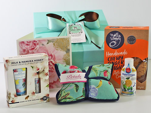 get well soon gift hamper with wheatie bag, handmade ginger cookies, lip balm, handcream, flavour for water, all NZ made