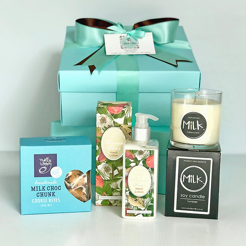 Gorgeous gift hamper with all NZ made gifts, baked pear scented soy candle, handmade choc cookies, French pear body lotion