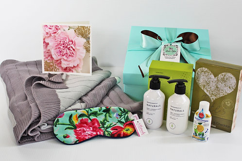 gift for women with cancer, soft blanket, natural body lotion and body wash, savoury snacks, velvet eyemask, water flavour