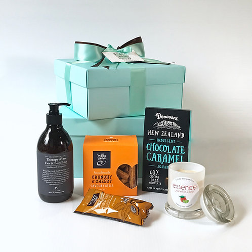 mens gift hamper delivered, face & body balm with soy candle & snacks, Hibiscus Coast Auckland gift hampers