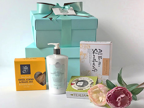 womens gift hamper containing white orchid body lotion, chai tea, shortbread cookies and biscotti. womens gift basket nz