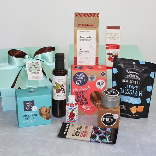 GF gift hamper, gf cookies, coffee, chocolate, dessert sauce, strawberry chocolate crisps, and baked pear soy candle