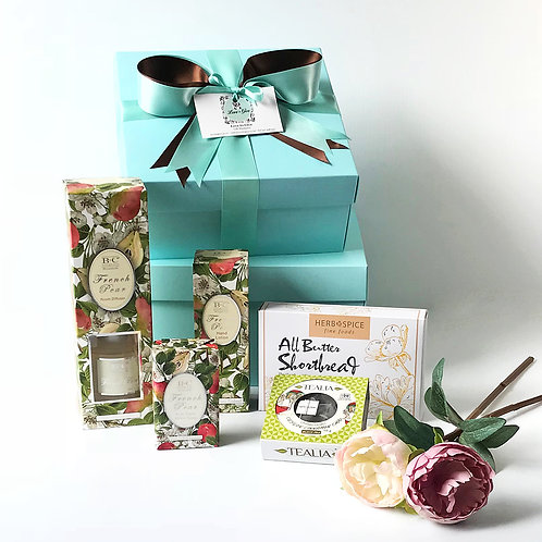 Gorgeous gift hamper for women contains French Pear room diffuser, French Pear body lotion and soap, chai tea, shortbread