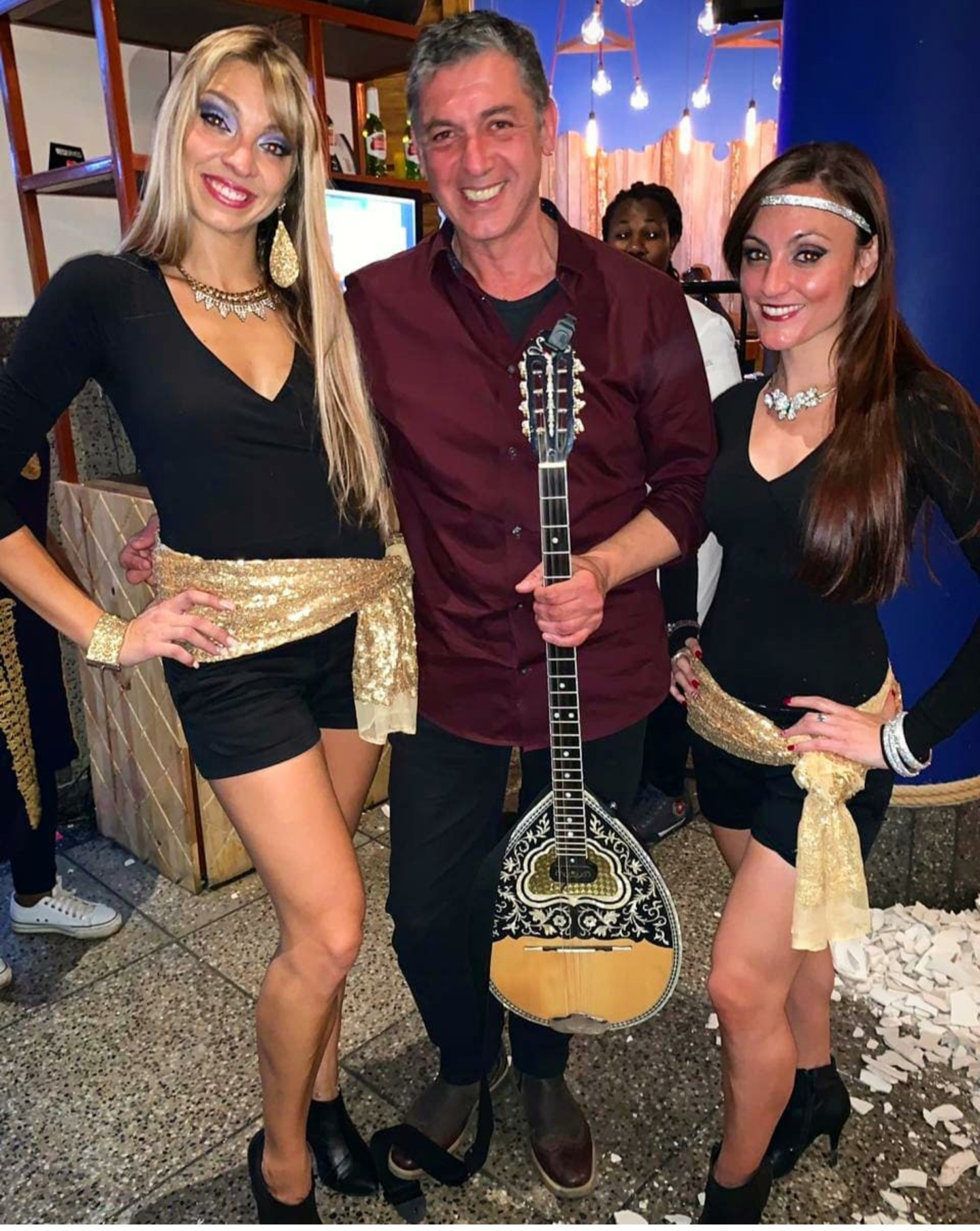 Bouzouki Player and Greek Dancers