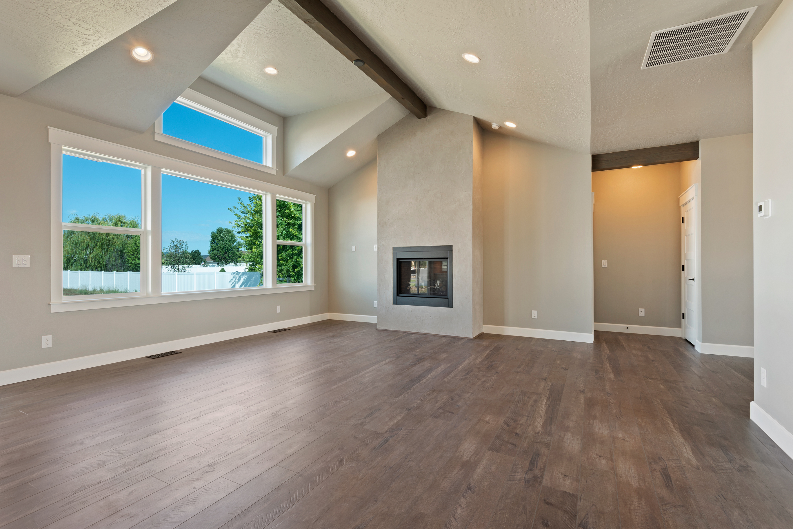Open Floor Plan, Beautiful Fireplace and Flooring Detail