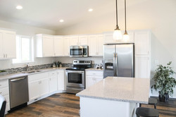 Renovated Kitchen and Open Floor. LVP, Tile and Counters