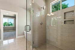 Bathroom, New Construction Gray subway tiles and White Quartz Counter