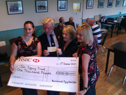 BFC Cafe hand over a cheque