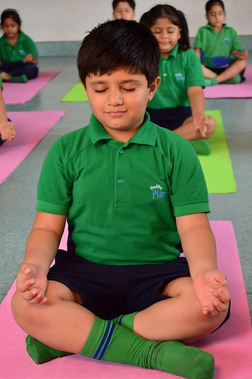 Nehru World School Ghaziabad student during yoga