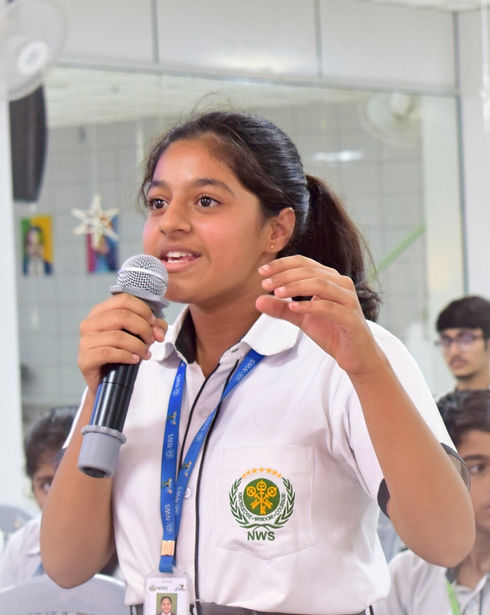 Nehru World School Ghaziabad Student in Auditorium