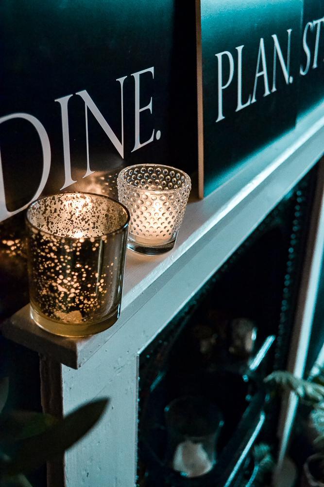 gold tea light, signage, fireplace