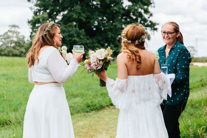 One of our planners Kerry greeting the newlyweds after the ceremony.