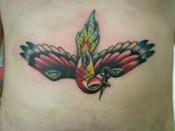 flaming sparrow tattoo.jpg