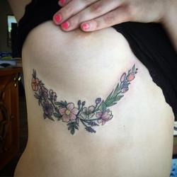 🌸Dainty flower tattoos on a beautiful woman. 🌿🌼_._._⚡️www.QueenofCupsTattoo.com⚡️_._._._