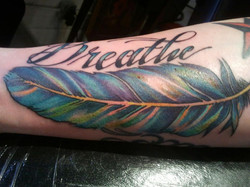 feather color tattoo