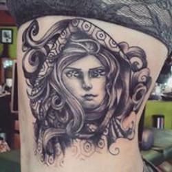 Luzcia's girlface tattoo