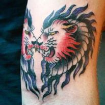 heart faced lions tattoo