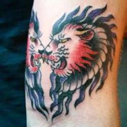 heart faced lions tattoo