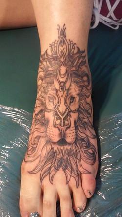 lion foot tattoo