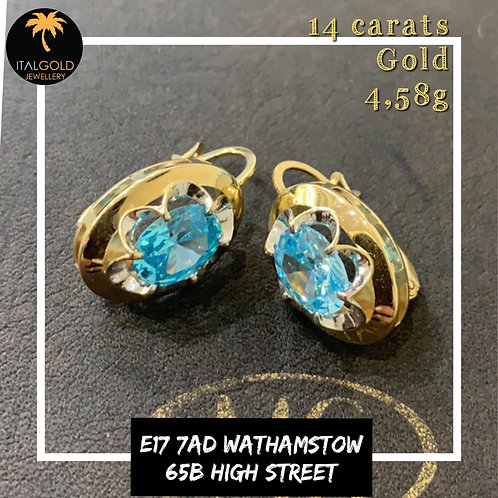 Earrings with blue stone