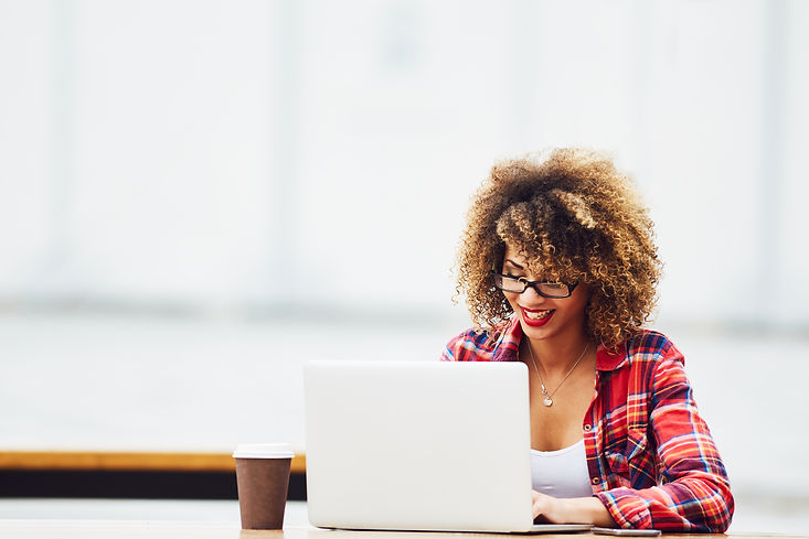Young woman working on laptop .jpg