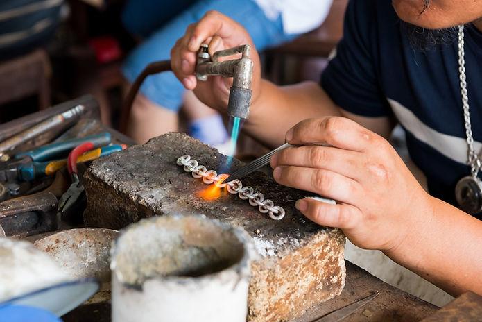 Silversmith hand-crafting a bracelet_edited.jpg