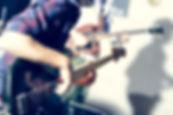 man playing guitar music