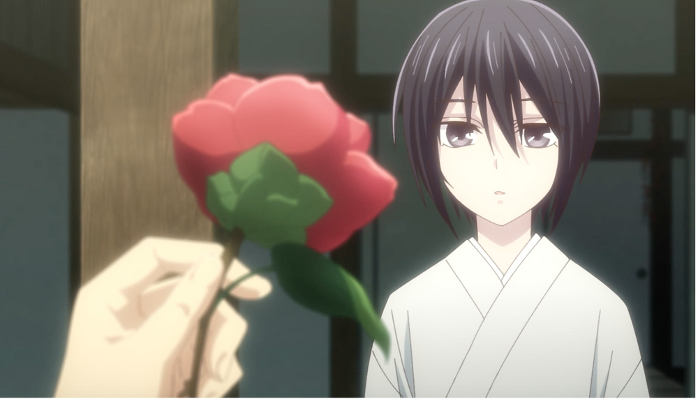 A screenshot of Akito with a red camellia from EP2