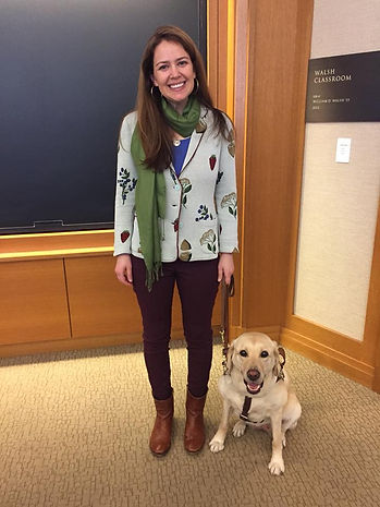 Zoe and Kristin pose in a classroom at Harvard. Both are smiling!