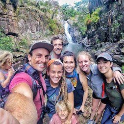 Guests hike to the waterfall