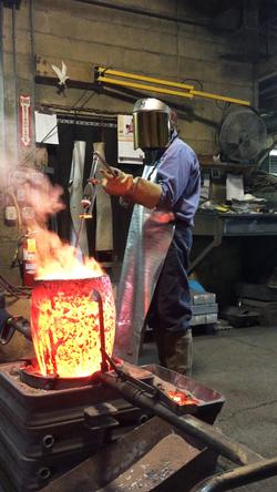 Edson Anbar Foundry - checking metal tem