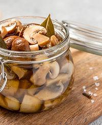 Pickled mushrooms in a glass jar close-u