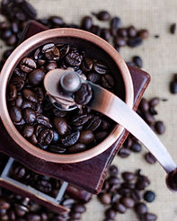 Coffee beans and a wooden grinder.jpg