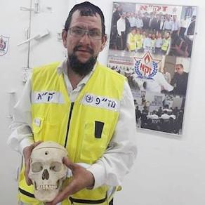 Why was a Jewish Zaka volunteer summoned to bury 50-year-old human skull?