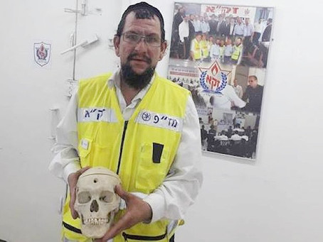 Why was a Jewish Zaka volunteer summoned to bury 50-year-old human skull?