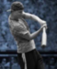 Man hitting a wiffleball