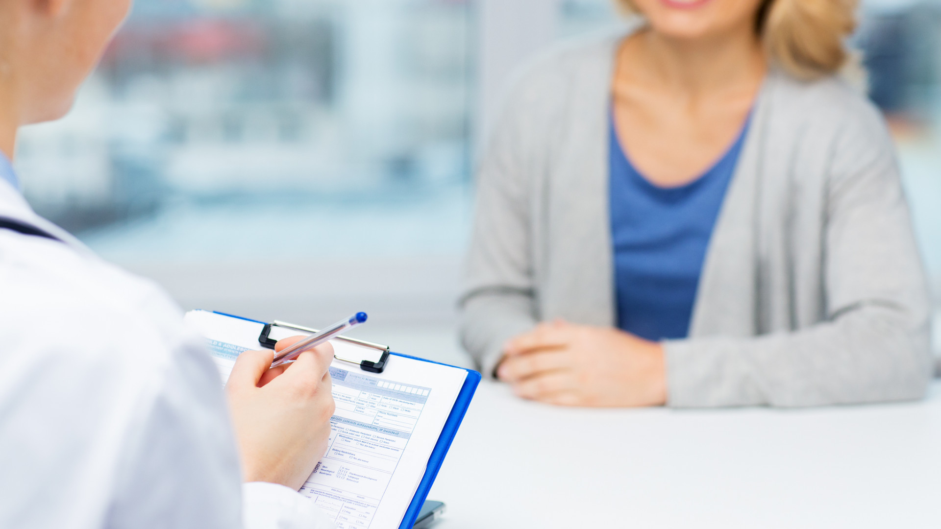 close-up-of-doctor-and-woman-meeting-at-
