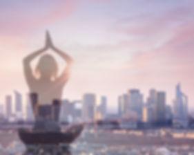 Double exposure of woman practicing yoga